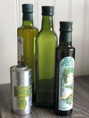 Grønne glassflasker med olivenolje sunt fett fettsmak